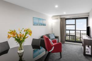 A seating area at Waldorf St Martins Apartments Hotel