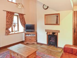 A television and/or entertainment center at Oak Tree Cottage, Penrith