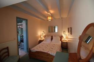 Un ou plusieurs lits dans un hébergement de l'établissement Le Petit Chêne Vert