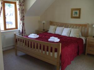A bed or beds in a room at Lough Rynn Castle Self Catering (Official)