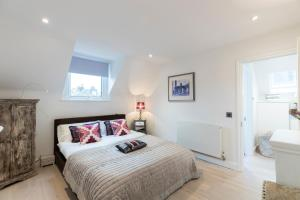 Ein Bett oder Betten in einem Zimmer der Unterkunft Modern 2bed/1bath close to Putney