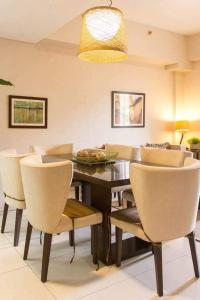 A restaurant or other place to eat at Pico de Loro 2br condo