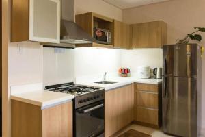A kitchen or kitchenette at Pico de Loro 2br condo