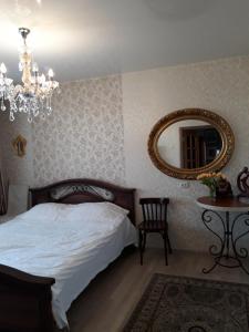 Кровать или кровати в номере Apartment on Kuybesheva