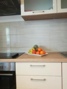 Kuchyň nebo kuchyňský kout v ubytování Apartment Leonora
