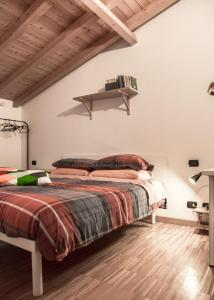 A bed or beds in a room at Casa Rosa
