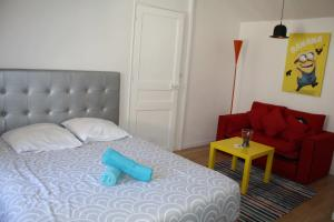 Een bed of bedden in een kamer bij Casa Ammirati Apartments