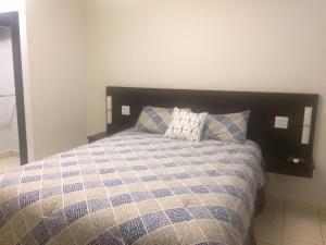 A bed or beds in a room at Ecovivienda Apartment