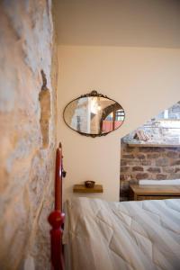 La Residenza Dei Cappuccini tesisinde bir odada yatak veya yataklar