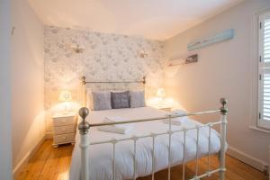 Een bed of bedden in een kamer bij Pugwash