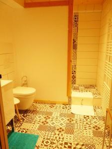 Salle de bains dans l'établissement Chez Henriette
