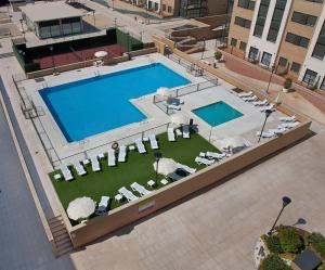 A view of the pool at Compostela Suites or nearby