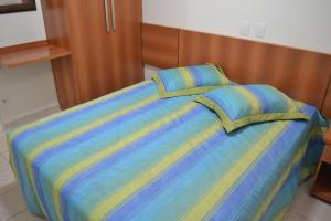 A bed or beds in a room at Serra Park TURISMO
