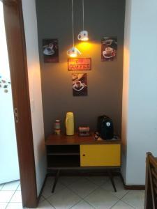 Coffee and tea-making facilities at Apartamento Enseada do Suá