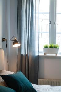 Säng eller sängar i ett rum på Cozy Studio