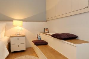 A bed or beds in a room at Maraschino Apartment Zadar