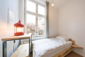 Ein Bett oder Betten in einem Zimmer der Unterkunft Apartments Benkert