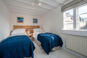 A bed or beds in a room at Charming Period Cottage
