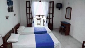 A bed or beds in a room at Hotel Selenunda