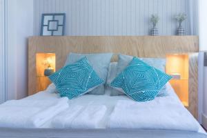 Cama o camas de una habitación en Livemalaga Boutique Apartments