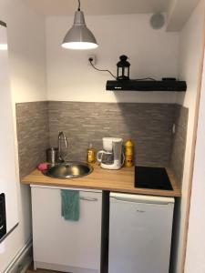 A kitchen or kitchenette at holiday's room