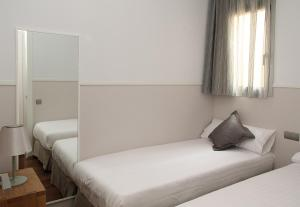 A bed or beds in a room at MH Apartments Center