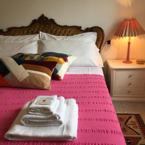 Un pat sau paturi într-o cameră la Good Morning Pisa