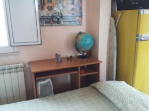 Un pat sau paturi într-o cameră la Monolocale Monteverde
