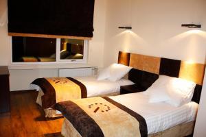 Кровать или кровати в номере Boutique Hotel's Sosnowiec