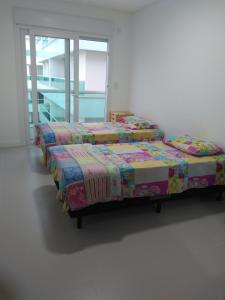 Cama o camas de una habitación en Estrela Verde