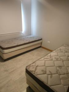 Una cama o camas en una habitación de Complejo Rafina Villa Gesell