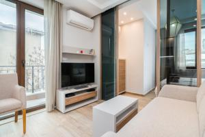 A television and/or entertainment center at *M&M* Modern & Multifunctional One Bedroom Apartment