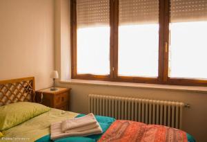 Letto o letti in una camera di Casa Jacquard