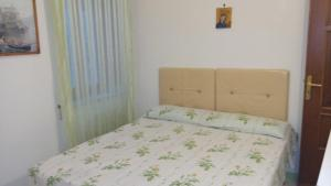 A bed or beds in a room at Francesca House