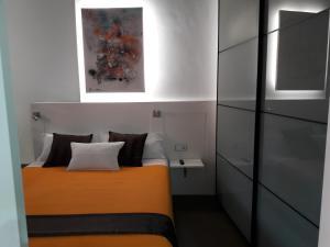 Ένα ή περισσότερα κρεβάτια σε δωμάτιο στο Apartaments Entre Volcans