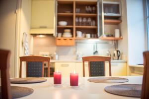 A kitchen or kitchenette at Studio at Lauteri 8