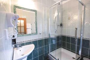 Koupelna v ubytování Hotel Diana & apartments