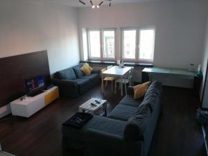 Svetainės erdvė apgyvendinimo įstaigoje Live Inn Apartments pl.Konstytucji.