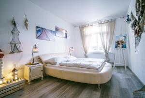 Ένα ή περισσότερα κρεβάτια σε δωμάτιο στο Fish & Fish