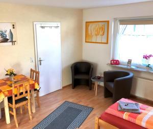 Ein Sitzbereich in der Unterkunft Abelia Apartment