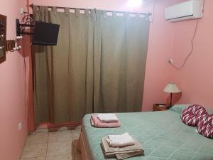 Una cama o camas en una habitación de Departamento Zonda