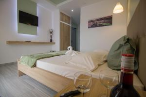 A bed or beds in a room at Maroula Studios