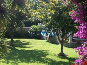 Jardín al aire libre en Duplex Playa de Rons