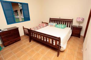 A bed or beds in a room at Sitio Morro Alto