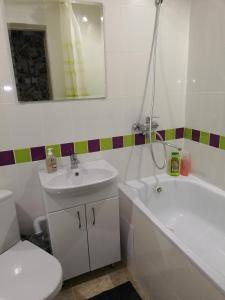 Ванная комната в Apartment Na Ostrovskogo