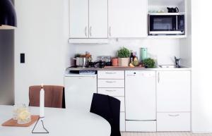 Een keuken of kitchenette bij Kolding Hotel Apartments