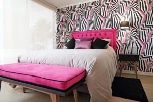 Cama o camas de una habitación en Espacio Arauco