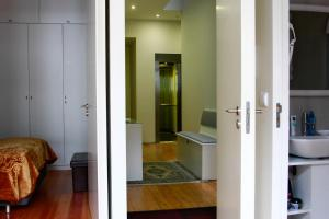 Uma televisão e/ou sistema de entretenimento em Apartamentos Villa Bolhao