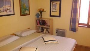 Postelja oz. postelje v sobi nastanitve Pave