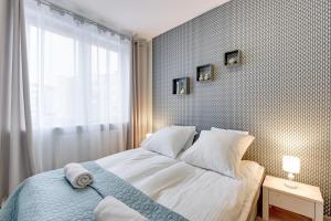 Lova arba lovos apgyvendinimo įstaigoje Apartamenty Apartinfo Center